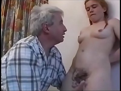 18-year-old redheaded girl makes a blowjob to an old-man